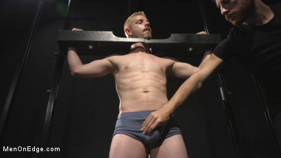 Photo number 2 from Uncut Stud Edged Beyond His Limit in Stocks shot for Men On Edge on Kink.com. Featuring Cody Winter in hardcore BDSM & Fetish porn.