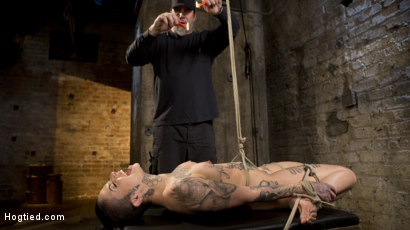 Photo number 1 from Tattooed Pain Slut Endures Brutal Bondage with Agonizing Torment shot for Hogtied on Kink.com. Featuring Leigh Raven and The Pope in hardcore BDSM & Fetish porn.