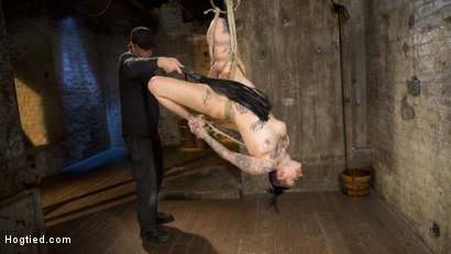 Photo number 13 from Tattooed Pain Slut Endures Brutal Bondage with Agonizing Torment shot for Hogtied on Kink.com. Featuring Leigh Raven and The Pope in hardcore BDSM & Fetish porn.