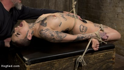 Photo number 15 from Tattooed Pain Slut Endures Brutal Bondage with Agonizing Torment shot for Hogtied on Kink.com. Featuring Leigh Raven and The Pope in hardcore BDSM & Fetish porn.