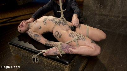 Photo number 10 from Tattooed Pain Slut Endures Brutal Bondage with Agonizing Torment shot for Hogtied on Kink.com. Featuring Leigh Raven and The Pope in hardcore BDSM & Fetish porn.
