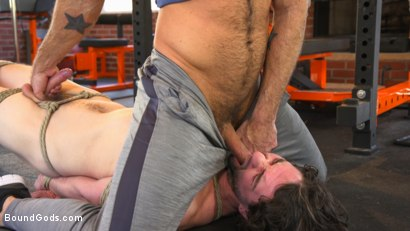 Bound gym whore gets the cum fucked right out of his uncut cock