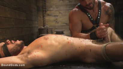 Photo number 14 from Horny Sub is Tormented With the Fucksaw and Hot Wax Pendulums!  shot for Bound Gods on Kink.com. Featuring Scott DeMarco and Dakota Rivers in hardcore BDSM & Fetish porn.