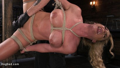 Photo number 8 from Phoenix Marie and Her Big Tits are Captured in Bondage and Tormented shot for Hogtied on Kink.com. Featuring The Pope and Phoenix Marie in hardcore BDSM & Fetish porn.