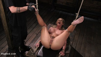 Photo number 11 from Phoenix Marie and Her Big Tits are Captured in Bondage and Tormented shot for Hogtied on Kink.com. Featuring The Pope and Phoenix Marie in hardcore BDSM & Fetish porn.