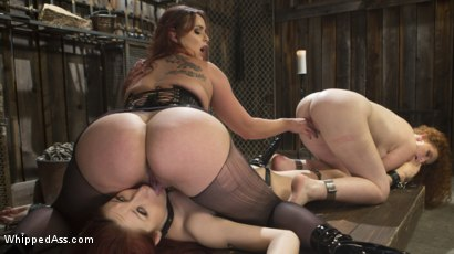 Photo number 2 from Young New Slave Brutally Inducted Into The Redhead Lesbian Dungeon shot for Whipped Ass on Kink.com. Featuring Bella Rossi, Violet Monroe and Emma Heart in hardcore BDSM & Fetish porn.