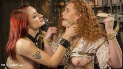 Photo number 4 from Young New Slave Brutally Inducted Into The Redhead Lesbian Dungeon shot for Whipped Ass on Kink.com. Featuring Bella Rossi, Violet Monroe and Emma Heart in hardcore BDSM & Fetish porn.