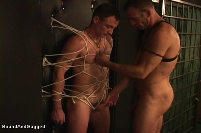 Photo number 2 from Masters & Slaves 1: The Slave Performs shot for Bound And Gagged on Kink.com. Featuring Aaron Tanner, Steve Ross and Jason Branch in hardcore BDSM & Fetish porn.