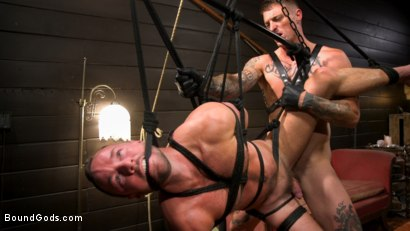 Photo number 2 from Captive slave Alex Hawk submits to Daddy Dane Stewart shot for Bound Gods on Kink.com. Featuring Dane Stewart  and Alex Hawk in hardcore BDSM & Fetish porn.