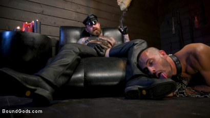 Photo number 3 from Muscular Leather Daddy Smokes Cigars & Brutally Fucks Submissive Boy shot for Bound Gods on Kink.com. Featuring Jack Dixon and Chance Summerlin in hardcore BDSM & Fetish porn.