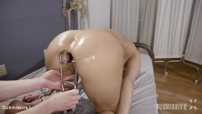 Evil Nurse Does an Anal Exam on Captive Female