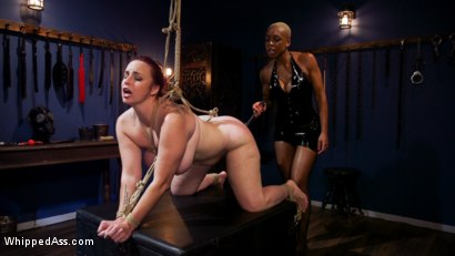 Photo number 12 from Lesbian Latex Blasphemy: Ashley Paige Whips the Sin Out Of Bella Rossi shot for Whipped Ass on Kink.com. Featuring Ashley Paige  and Bella Rossi in hardcore BDSM & Fetish porn.