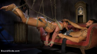 Muscled mistress playing with a submissive couple bdsm
