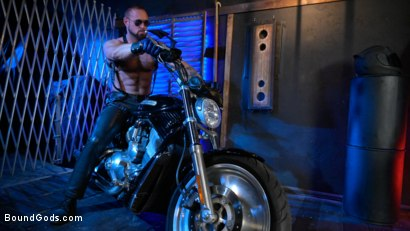 Photo number 2 from Rode Hard: Dillon Diaz Dominated On Michael Roman's Motorcycle  shot for Bound Gods on Kink.com. Featuring Michael Roman and Dillon Diaz in hardcore BDSM & Fetish porn.
