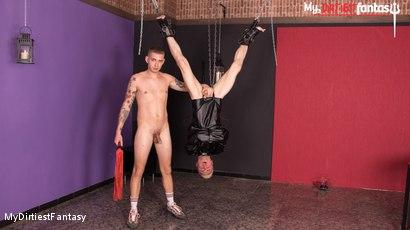 Adam gets hung upside for a brutal punishment