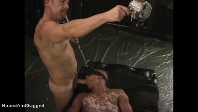 Photo number 18 from BONDAGE BUDDIES: MILITARY TIES: Hot Wax on a Floating Bondage Board shot for Bound And Gagged on Kink.com. Featuring Diego Alvarez and Doug Jeffries in hardcore BDSM & Fetish porn.