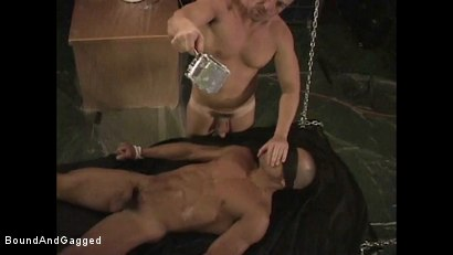 Photo number 3 from BONDAGE BUDDIES: MILITARY TIES: Hot Wax on a Floating Bondage Board shot for Bound And Gagged on Kink.com. Featuring Diego Alvarez and Doug Jeffries in hardcore BDSM & Fetish porn.