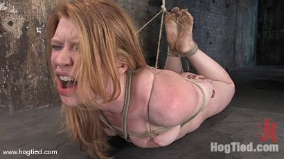 Madison Young stars in one of Hogtied's real time live shoots.