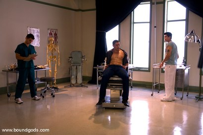 Photo number 1 from The Spanish Patient shot for Bound Gods on Kink.com. Featuring Romario Faria, TJ Young and Van Darkholme in hardcore BDSM & Fetish porn.