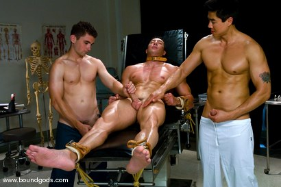 Photo number 4 from The Spanish Patient shot for Bound Gods on Kink.com. Featuring Romario Faria, TJ Young and Van Darkholme in hardcore BDSM & Fetish porn.