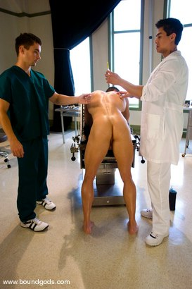 Photo number 2 from The Spanish Patient shot for Bound Gods on Kink.com. Featuring Romario Faria, TJ Young and Van Darkholme in hardcore BDSM & Fetish porn.