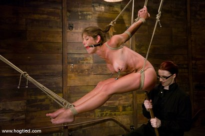 Photo number 4 from Welcome Felony to her fist Hogtied shoot.<br>	34d-24-34 are our new favorite numbers. shot for Hogtied on Kink.com. Featuring Claire Adams and Felony in hardcore BDSM & Fetish porn.