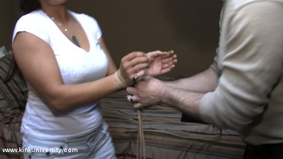 Photo number 7 from Lochai Demonstrates 2 Easy Ties You Can Learn in Minutes shot for Kink University on Kink.com. Featuring Lochai and Bella Rossi in hardcore BDSM & Fetish porn.