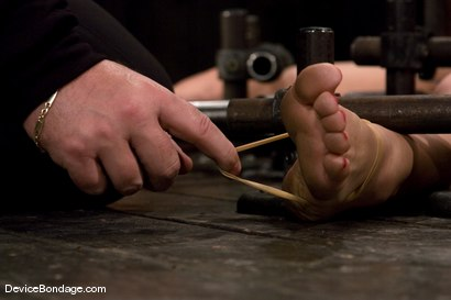Photo number 8 from Tia Ling<br>Impaled in a one person prison. shot for Device Bondage on Kink.com. Featuring Tia Ling in hardcore BDSM & Fetish porn.