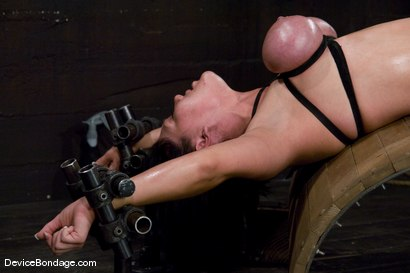 Photo number 12 from Claire Dames<br>Her huge tits, brutally bound and oiled. <br>Her body spread and tortured.<br> shot for Device Bondage on Kink.com. Featuring Claire Dames in hardcore BDSM & Fetish porn.