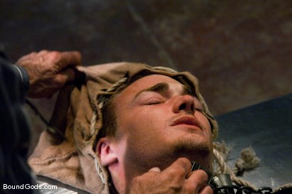 Photo number 2 from The Slaughterhouse: Part One <br /> The Head Butcher shot for Bound Gods on Kink.com. Featuring Nick Moretti, DJ and Christian Wilde in hardcore BDSM & Fetish porn.