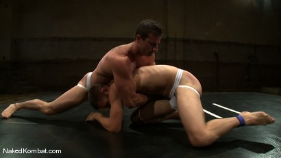 Photo number 6 from Rusty Stevens vs Tommy Defendi <br />The Oil Match shot for Naked Kombat on Kink.com. Featuring Rusty Stevens and Tommy Defendi in hardcore BDSM & Fetish porn.
