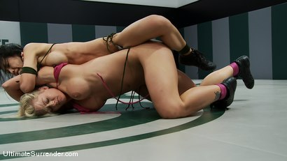 "Photo number 5 from Tia ""Jade"" Ling (2-1)<br>vs<br>Holly ""The Hit Man"" Heart (0-3) shot for Ultimate Surrender on Kink.com. Featuring Tia Ling and Holly Heart in hardcore BDSM & Fetish porn."