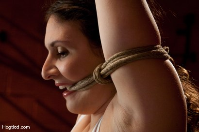 Photo number 1 from Sienna:  Looks Can Be Deceiving shot for Hogtied on Kink.com. Featuring Sienna in hardcore BDSM & Fetish porn.