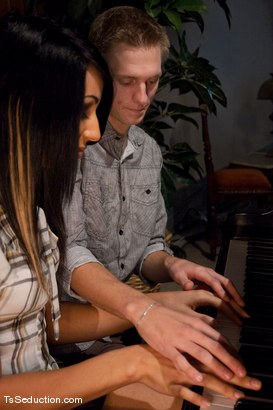 Photo number 1 from Honey Foxx and the Piano Teacher <br> Her 8 inch thick cock, plunges into his ass, his throat shot for TS Seduction on Kink.com. Featuring Honey FoXXX and Johnny in hardcore BDSM & Fetish porn.
