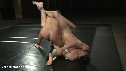 Photo number 5 from CJ vs Matthew Singer shot for Naked Kombat on Kink.com. Featuring Matthew Singer and CJ in hardcore BDSM & Fetish porn.