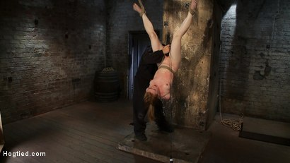 Photo number 9 from Redhead suspended by ankles with rope, face fucked<br>Flogged until her skin is bright pink. shot for Hogtied on Kink.com. Featuring Madison Young in hardcore BDSM & Fetish porn.