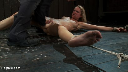 Photo number 7 from Rain somehow makes it the entire hour. She suffers her final orgasm of the day<br>Aftercare is next shot for Hogtied on Kink.com. Featuring Rain DeGrey and Isis Love in hardcore BDSM & Fetish porn.