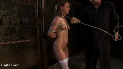 Photo number 4 from Pigtailed girl with thigh highs is bound, made to suck & swallow cock   Brutal BJ. Suck it bitch. shot for Hogtied on Kink.com. Featuring Jessie Cox in hardcore BDSM & Fetish porn.