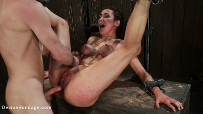 Photo number 11 from Princess Donna reduced to a common peasant <br>Countdown to Relaunch-14 of 20 shot for Device Bondage on Kink.com. Featuring James Deen, Princess Donna Dolore and Isis Love in hardcore BDSM & Fetish porn.